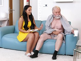 Dark haired hottie visits an old man relaxing on couch